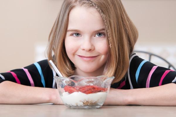 tween-girl-eating-yogurt